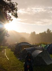 Sun and rain in a field of tents