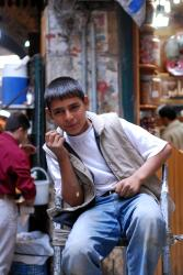 A young porter in Aleppo's souk