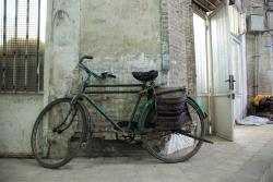 A bicycle waits for its owner