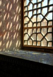 Light streams in on mosaic covered window sills