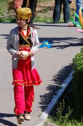 A young girl between ceremonies
