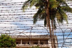 S21 or Tuol Sleng seen through barbed wire