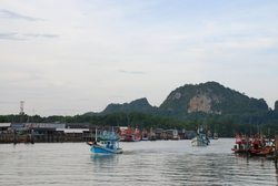 Fishing boats leaving Paknam Lang Suan