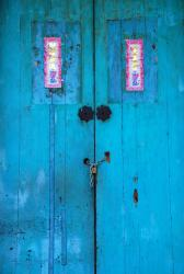 An intensely aqua coloured door