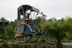 Friedel on a giant trishaw