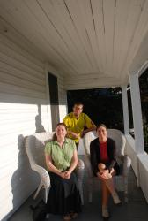 Melissa, Friedel and Andrew on the porch of Melissa's new home