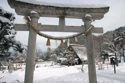 Torii gate and farmhouses