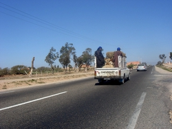 Crowed trucks on the way to Agadir