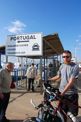 Locals check out our bikes, as we wait for the ferry
